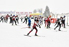 Young Koasalauf athletes racing in snowfall